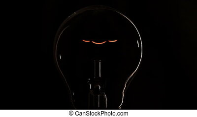 Light bulb on black background