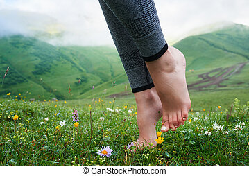 beautiful girls barefoot in cool morning dew on grass. -...