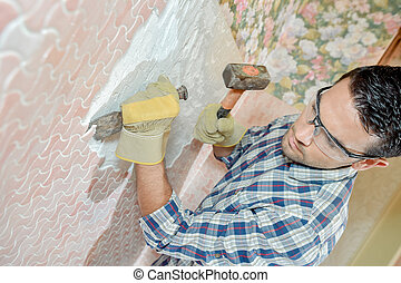 Chiselling off wall motif