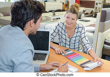 Woman in soft furnishings store choosing color scheme