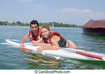 Couple on surfing board