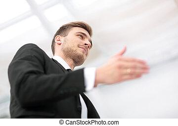 Portrait of handsome businessman offering a handshake -...