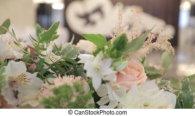 Beautiful magic bouquet lies on table close up, wedding preparation