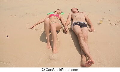 Young couple lying on the beach