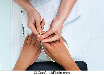 nail care, cuticle clipping in a beauty salon. View from...
