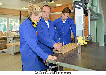 Carpenter with two apprentices