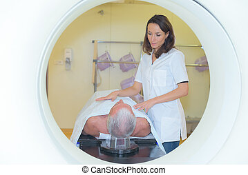 Nurse with patient going into MRI scanner
