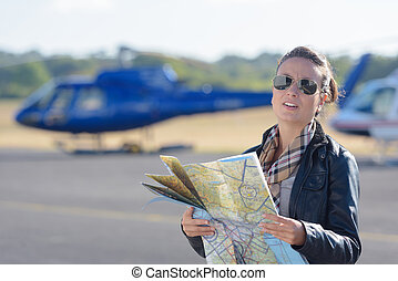 pilot holding a map with the background planes
