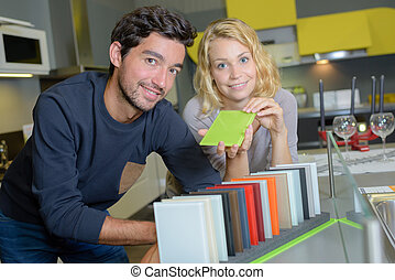 Couple choosing color scheme for kitchen