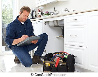 Plumber. - Professional plumber doing renovation in kitchen...