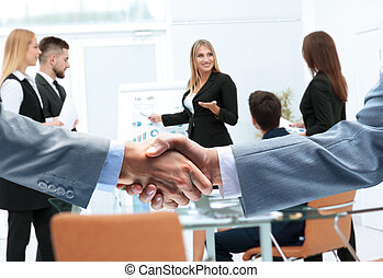 Mature businessman shaking hands to seal a deal with his...