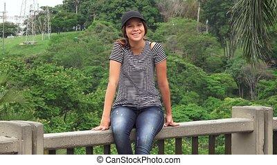 Smiling Teen Girl Sitting
