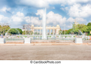 Defocused background with scenic fountain inside Gorky Park,...