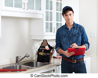 Plumber. - Professional plumber doing reparation in kitchen...