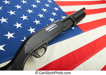 Shotgun without any lables on USA flag as a symbol of second...