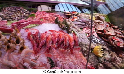 variety of Mediterranean seafood on counter spanish market....