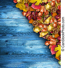 Autumn Leaves over a Natural Dark Wooden background. Old...