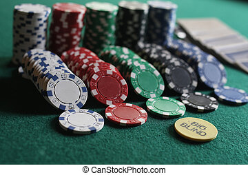 Poker chips and cards on the cloth - set of chips and cards...