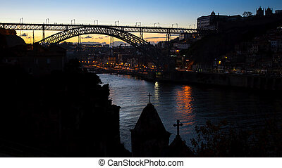 Night view the Dom Luis I Bridge at Douro River between the...