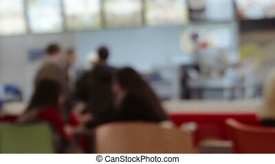 Food court and customers blurred background with bokeh...