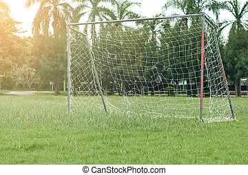 soccer field with red gate, white net in the morning