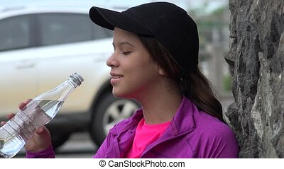 Teen Girl Drinking Bottled Water
