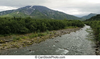 Glacial river among volcanoes. Kamchatka Peninsula in the...