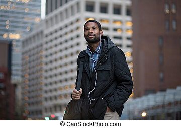 African American man en route to work in the city