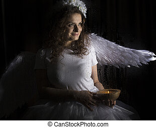 Portrait of angel and devil womans on a dark background,...