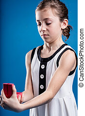 girl receiving no doubt the wrong gift - funny face of a...