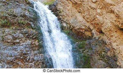 The first waterfall in the valley of the Issyk-Ata,...