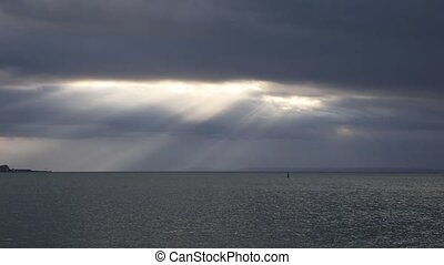 The sun's rays over the sea - The sun's rays breaking...