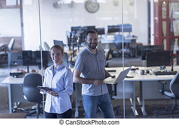 business couple at office - business couple working together...