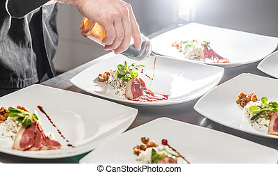 Chef decorating appetizer plate