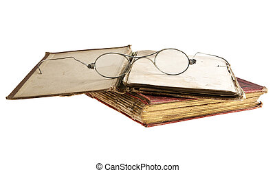 very old books and glasses is isolated on a white background