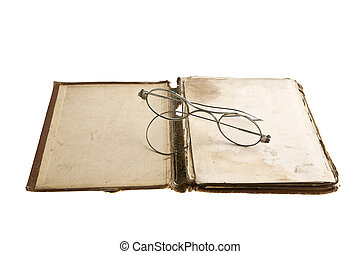very old book and glasses is isolated on a white background