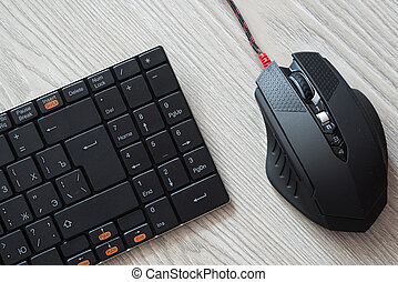 Top view of black computer mouse and keyboard with English...