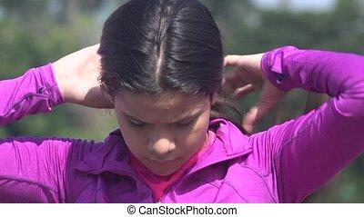 Female Teen Fixing Her Hair