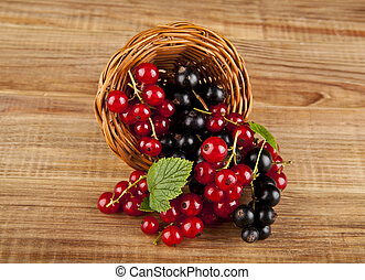 berries currants on a wooden background closeup
