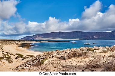 Beautiful seashore on Canary islands with untouched nature and a few ships