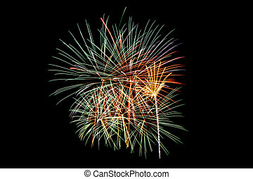 Colorful new year fireworks over dark sky