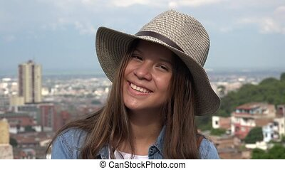 Smiling Female Teen Wearing Hat