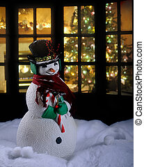 Christmas Snowman - A Christmas snowman in the snow at night...