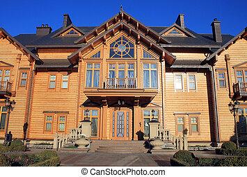 Wooden Honka house in Mezhyhirya, Kyiv region, Ukraine. -...