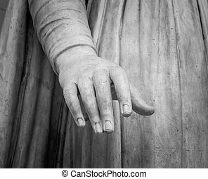 stone statue detail of human hand