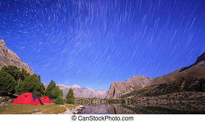 Mountains in the moonlight. Traces of stars similar to metory. Time Lapse. Pamir, Tajikistan