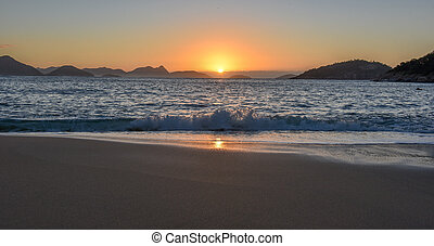 Beautiful Sunrise with the sun rising out of the ocean, Rio de Janeiro