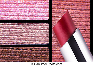 Closeup of makeup accessories color palette reds rose lips...