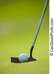 Golf club and ball in grass, France