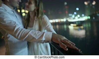 Love couple enjoying each other on the background of night...